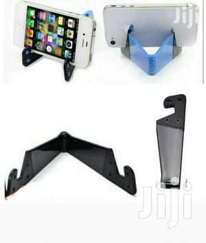 The Only Perfect Desk Phone Stand Universal Foldable v Shape | Accessories for Mobile Phones & Tablets for sale in Kampala