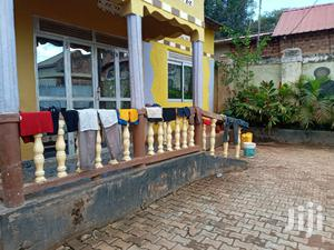 Home Of Three Bedrooms And Two Living Rooms With 8 Quaters | Houses & Apartments For Sale for sale in Wakiso