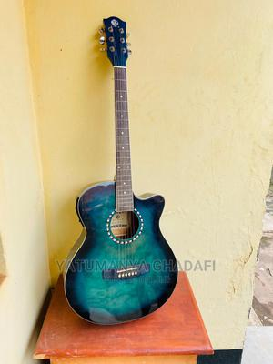 Acoustic Guitar Amplified and a Set of Strings, and a Pik | Musical Instruments & Gear for sale in Kampala